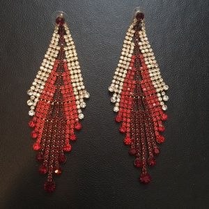 Red, gold, and crystal chandelier earrings.
